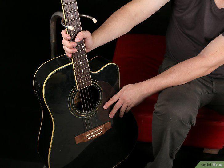 Trageți șiruri noi pe o chitară